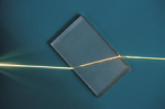 A ray of light being refracted in a plastic block